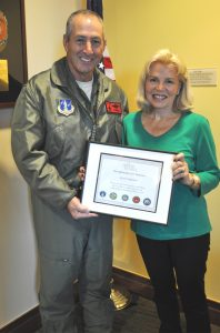 Patty Carpenter accepting her husband's Certificate of Appreciation